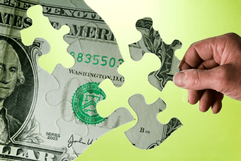 Staffing Budget Got You Down? Understand FTE's | Staff Budgets, a one dollar bill, turned into a puzzle piece