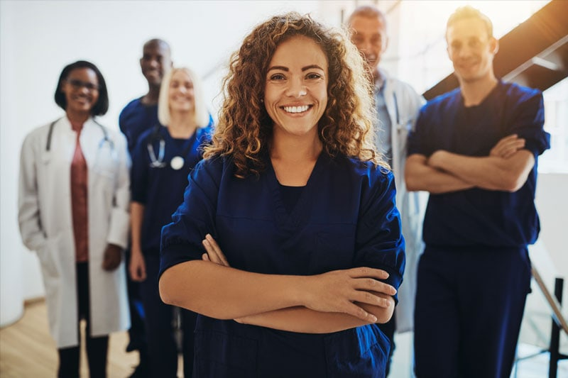 As Hospitals Rely On New Grads To Address Staffing Shortages, Recent Study Reveals Approximately 57% of New Nurses Will Leave Their Organization Within The First Two Years, group of healthcare workers standing together