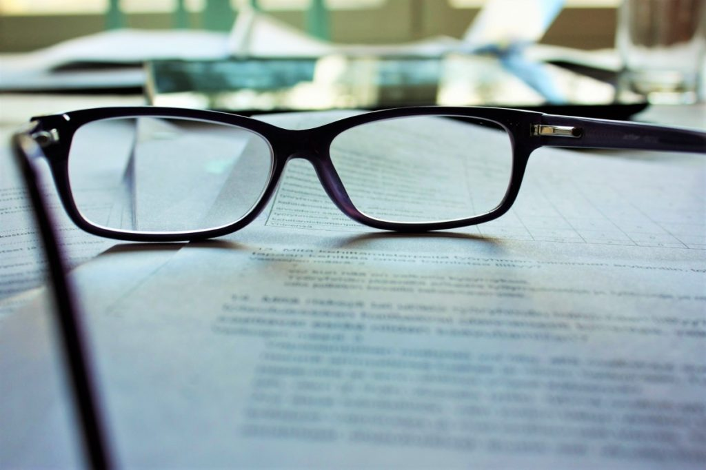 Here's What's Been Happening In Healthcare Leadership, glasses sitting on paperwork